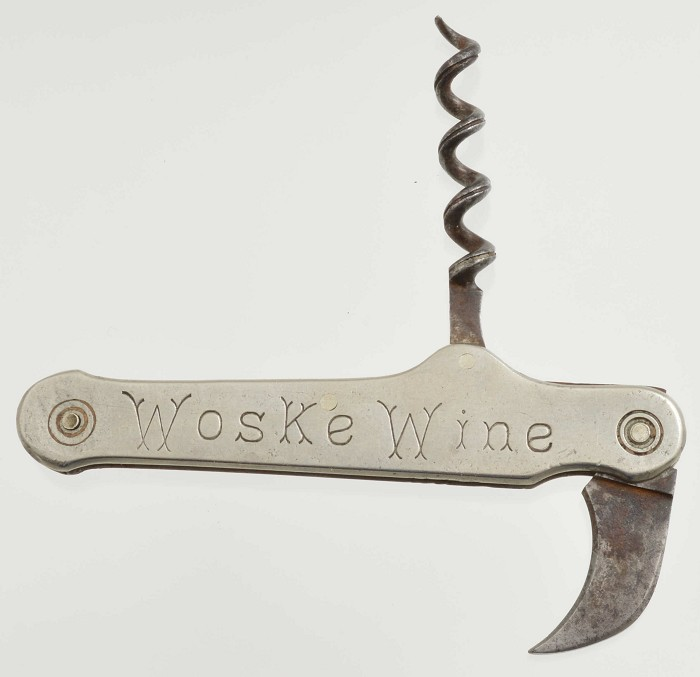 "KF05 Capsule cutter and corkscrew advertising ""Woske Wine."""