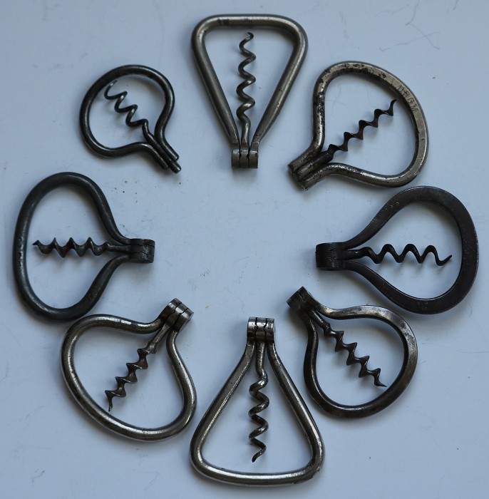 Collection of Eight Different Folding Bow Corkscrews